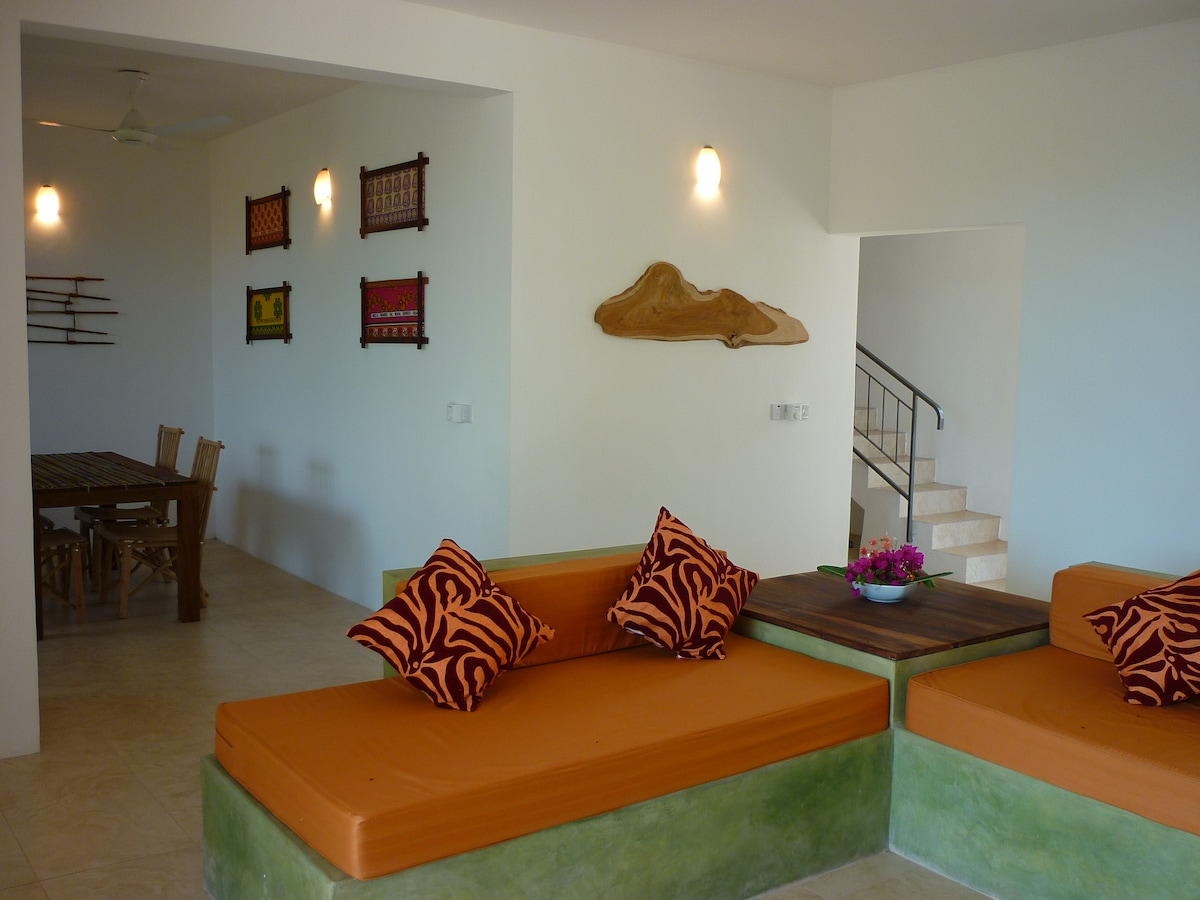 a large open space... living room, dining area and kitchen