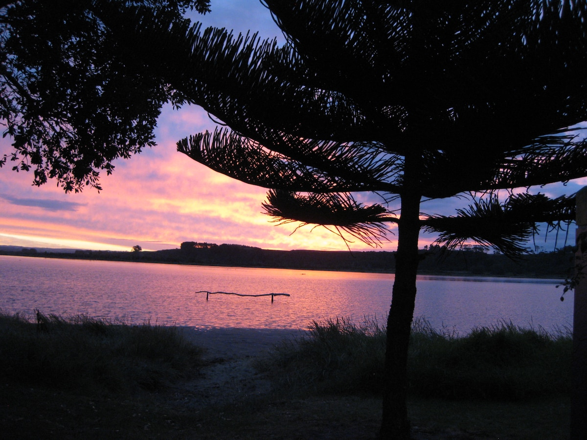 Enjoy this sunset view every evening over the esturay on the opposite side of the house from the beach