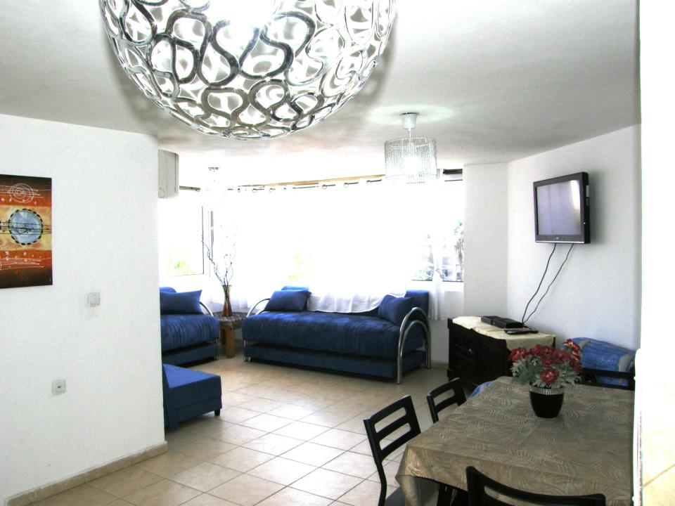 The spacious  living room with LG Cabels TV , Panoramic Windows , Free WIFI