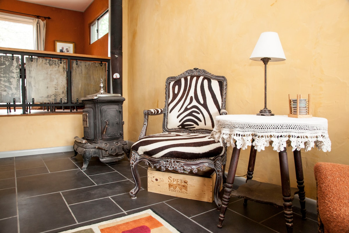 Living Room with Wood Stove and real Zebra hide chair