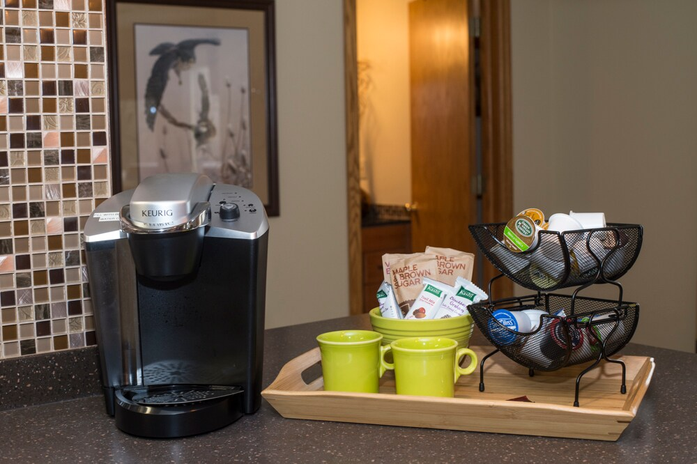 Enjoy a hot cup anytime with the Keurig.  Variety of coffee/tea provided plus some quick breakfast items to get you started.