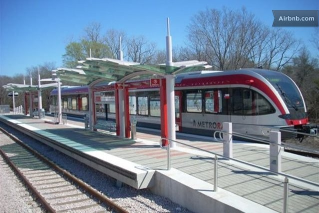 8 minutes to downtown via Cap Metro Rail train - stop is right behind house