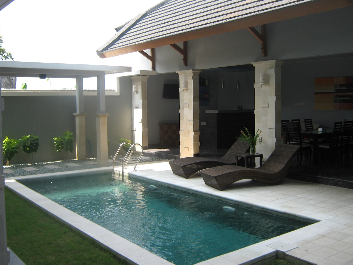 private pool with sunbeds