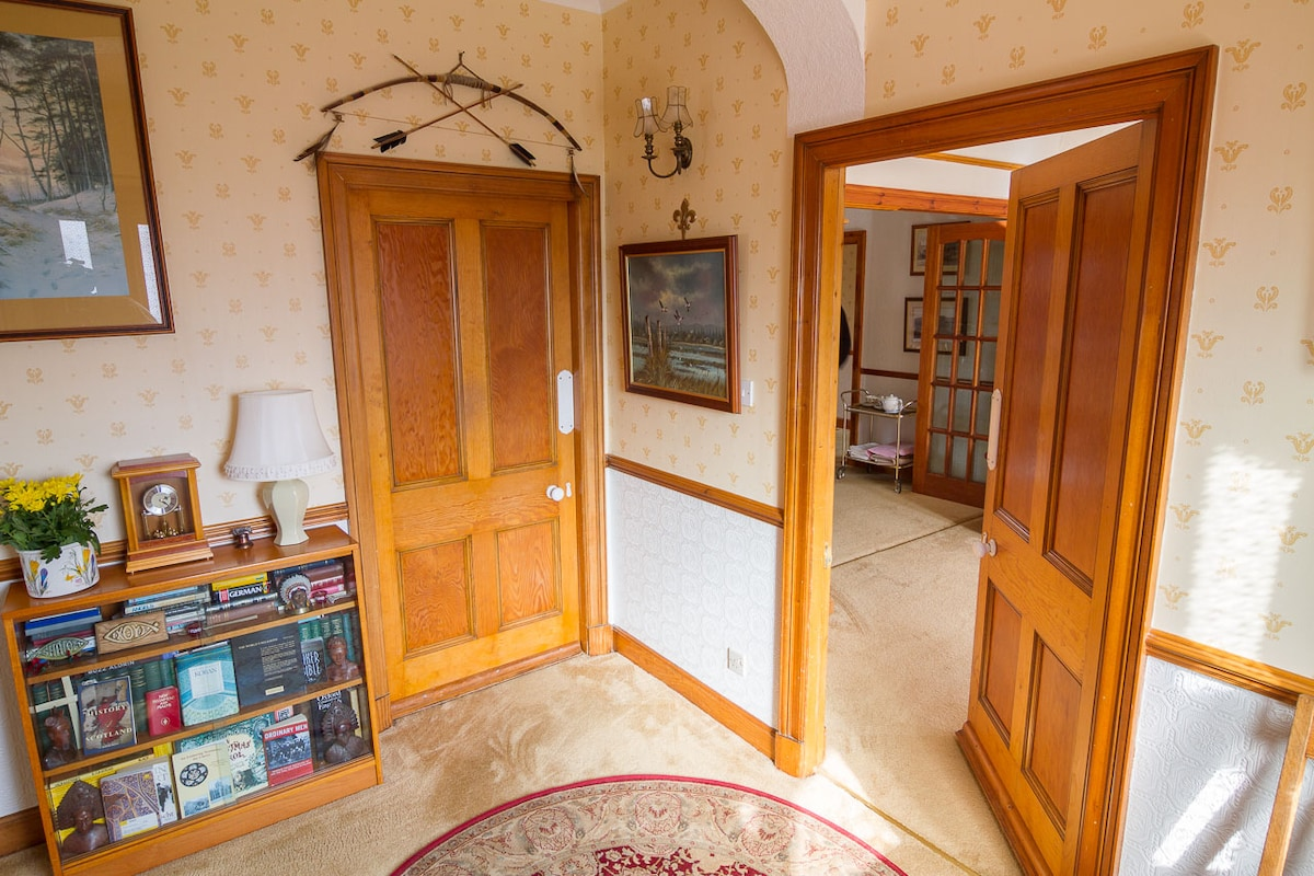 Generous, extra-wide doors typical of period homes like this - the hallway into the rest of the house