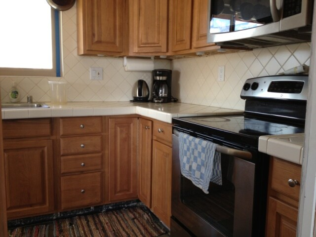 New electric range, coffee maker, hot water kettle.
