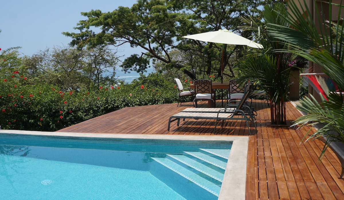 Pool and deck with ocean view