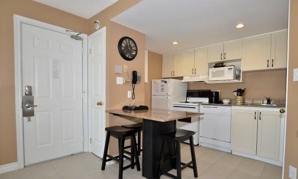 Full kitchen, fridge, stove, dishwasher and all dishes and utensils.