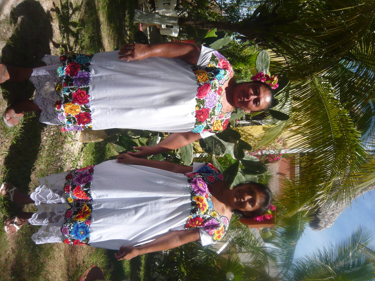 Your caretakers, Magally and Remigia in Mayan Dress