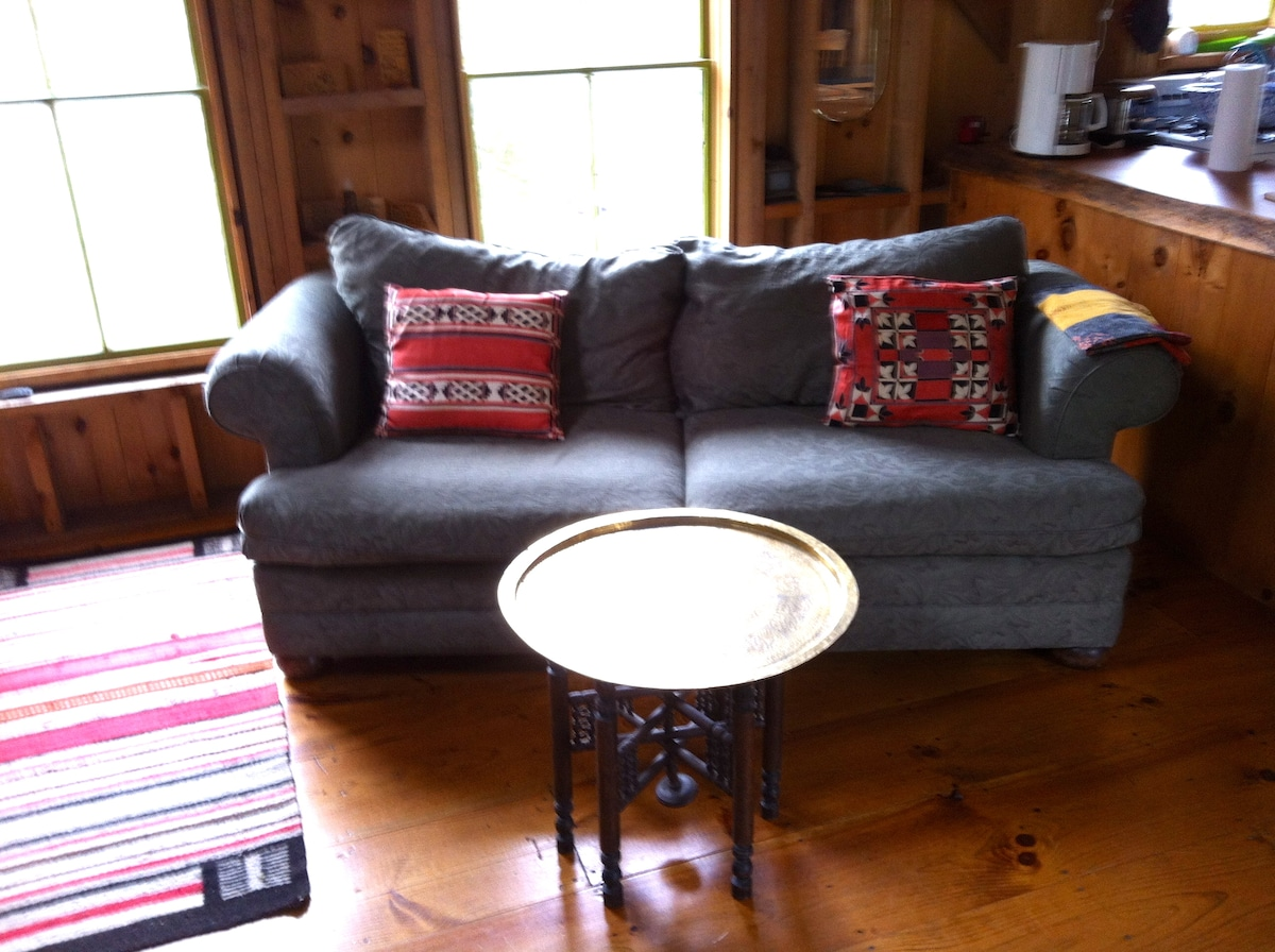 Couch in Living Room by Wood Stove Fireplace