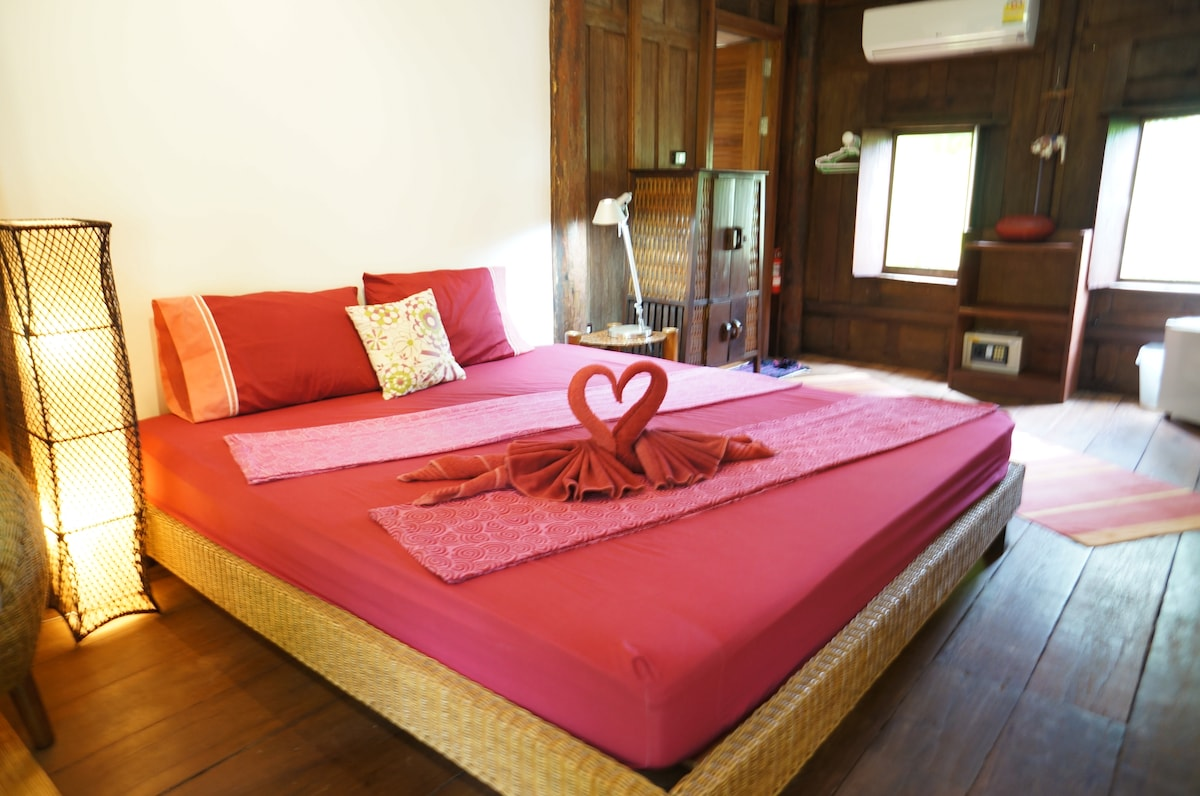 Romantic teak Thai-house on Island