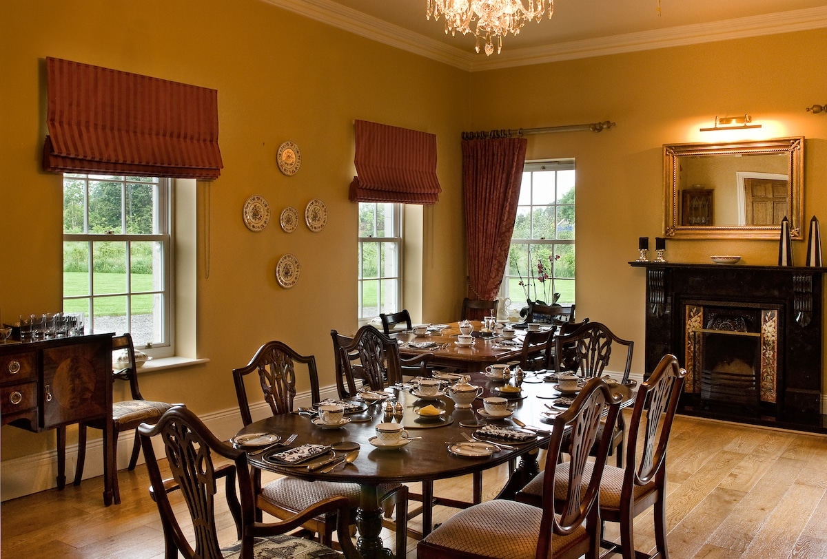 Rathellen House Dining room furnished with antique furniture and Waterford Crystal Chandelier