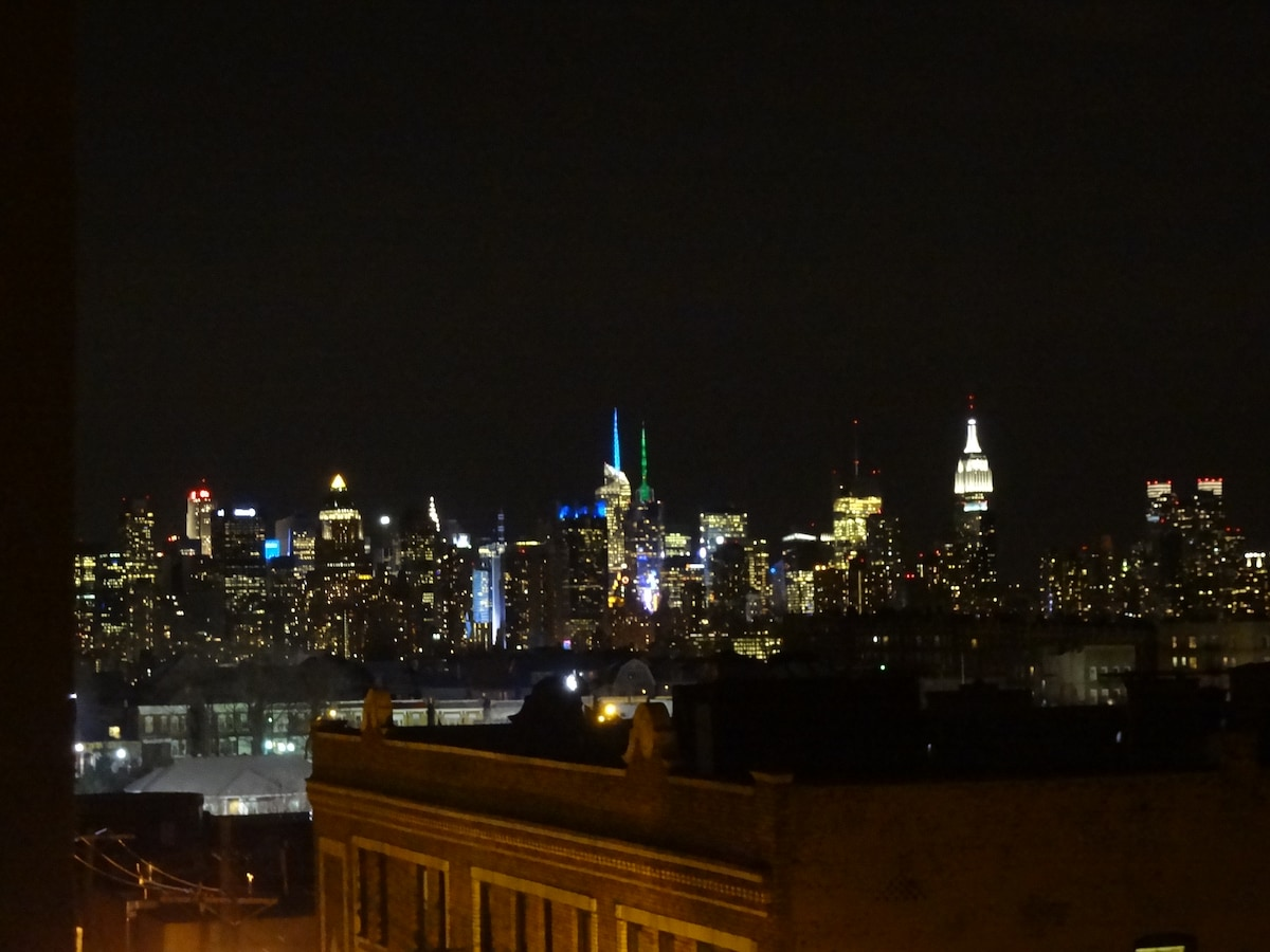 This is the side view from my balcony of the NYC skyline at night.