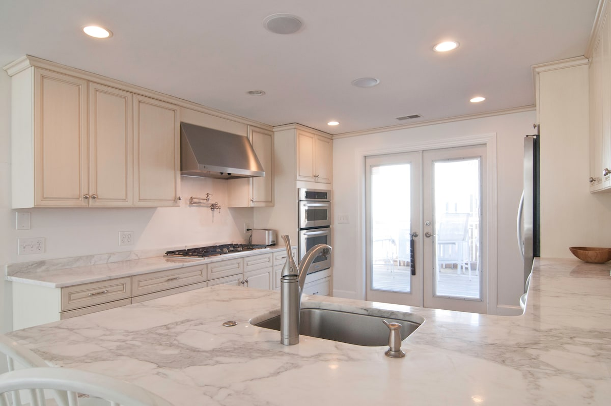 Open Chef's Kitchen with Gleaming Marble Countertops
