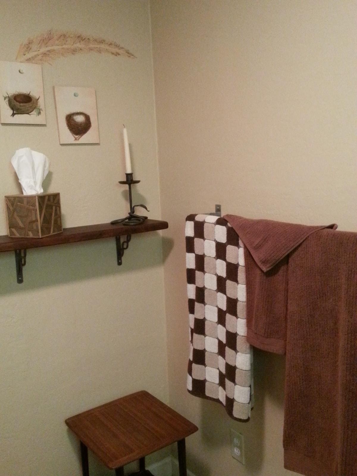 Nice size bathroom with tub/shower combo.