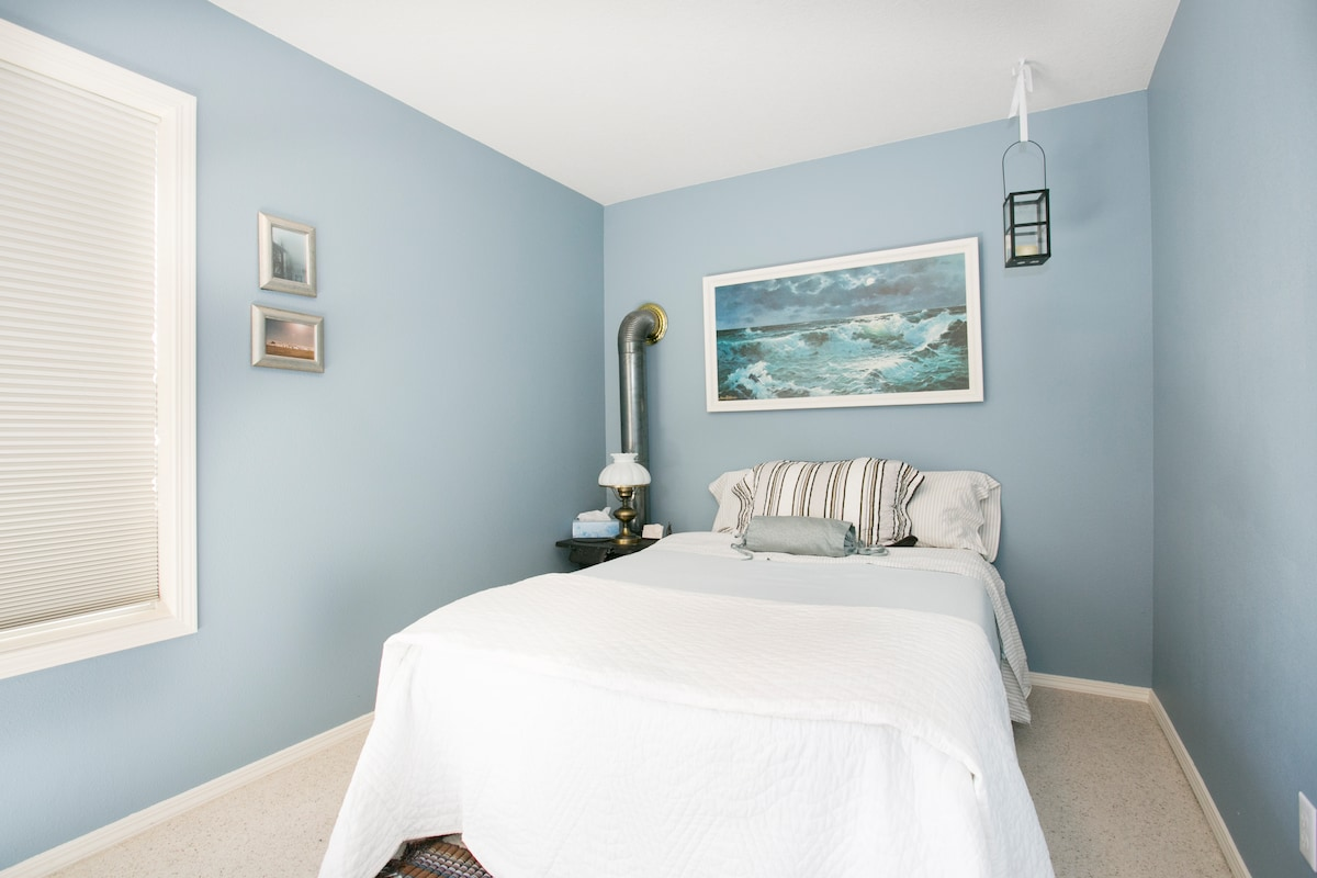 The Blue Room is just around the corner from the Vineyard View room. The double bed has a comfy foam topper.