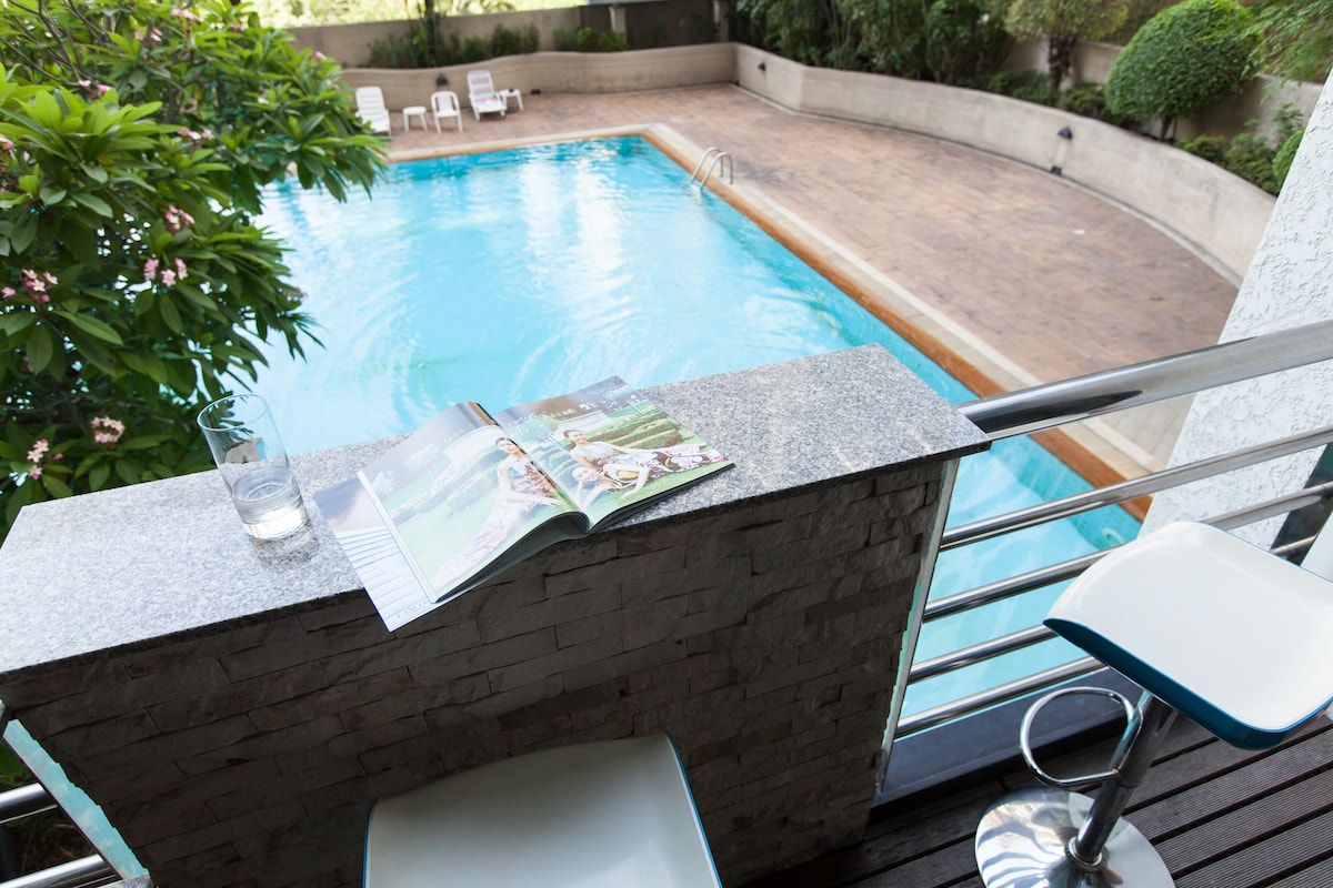 Amazing view of the pool from the balcony. The unit is nice and quiet retreat in the city.