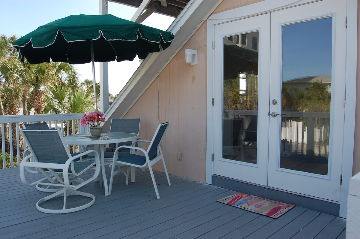 This is the deck outside the door to the apartment.  There is also another deck above the roof with a view of the ocean.