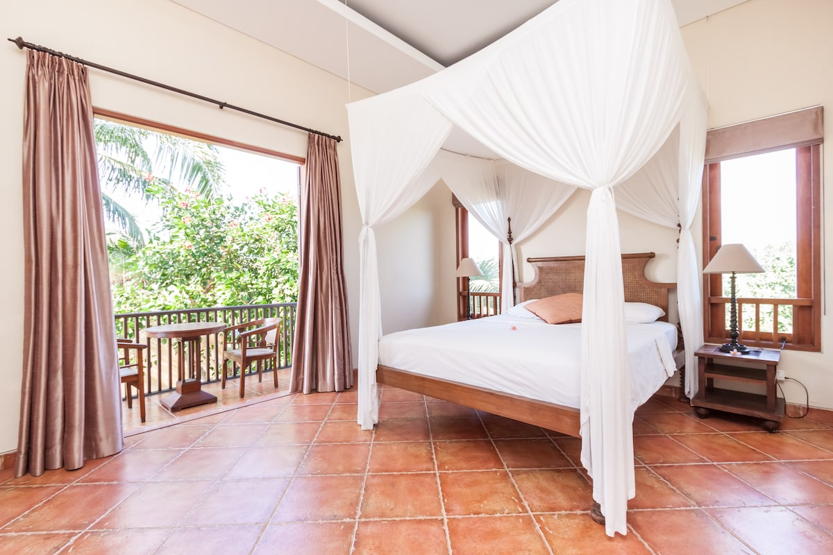 Bed room on second floor with terrace and view to mountains and rice fields.