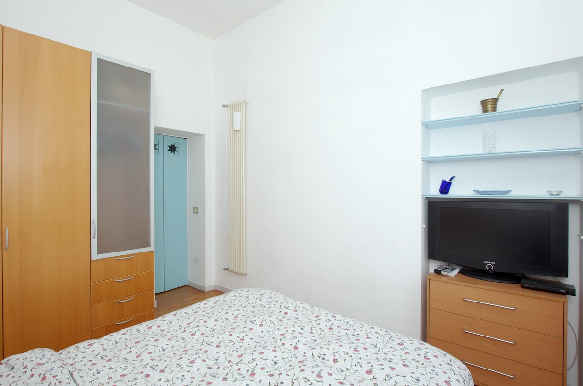 bed room,  chest of drawers and tv