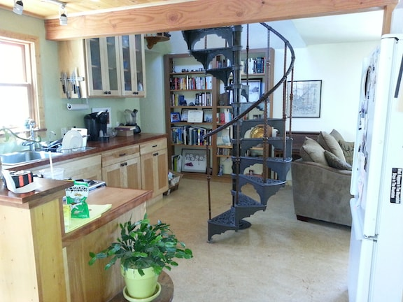 Kitchen with everything you need and the spiral staircase to my upstairs quarters