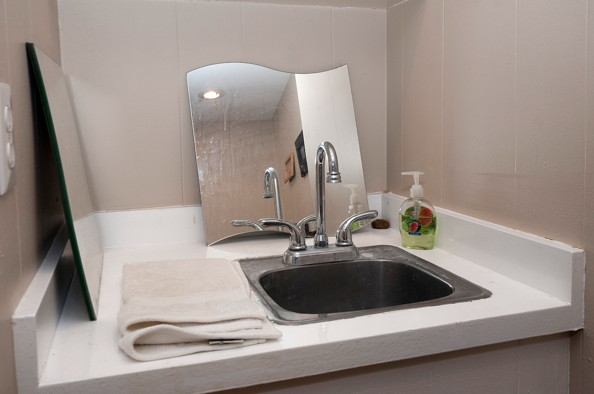 Here is the sink just behind your mini-bar area.