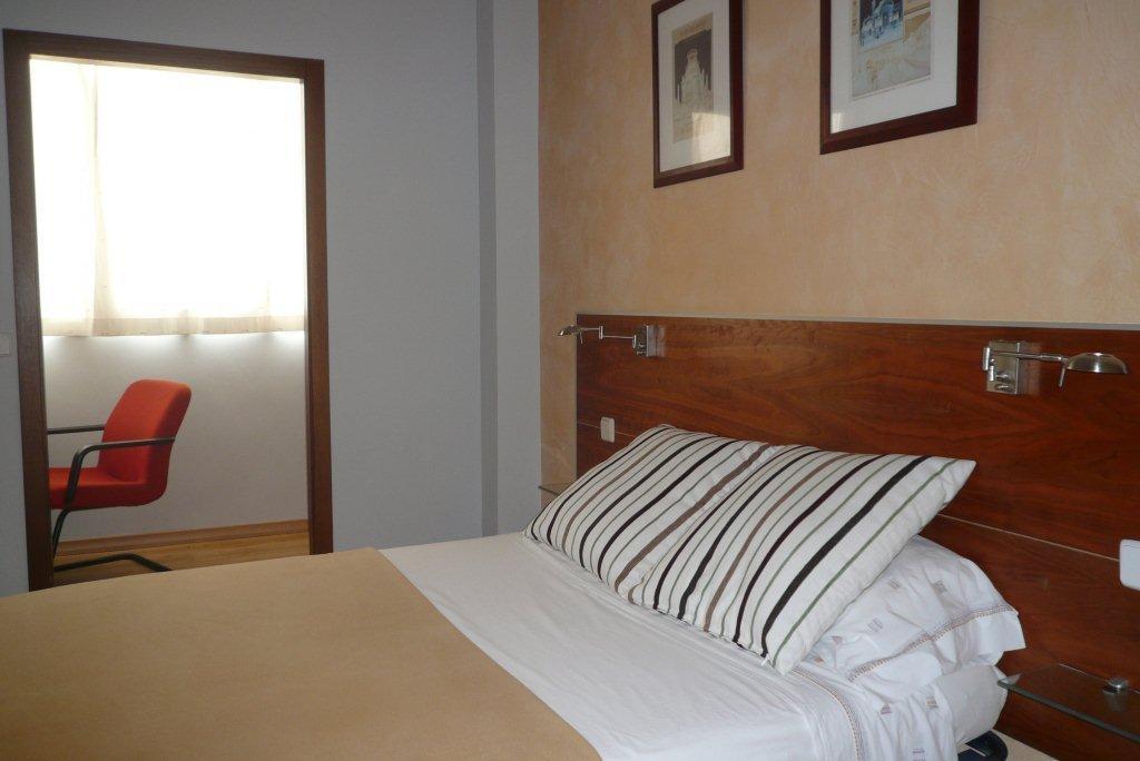 Dormitorio 1 con baño en suite