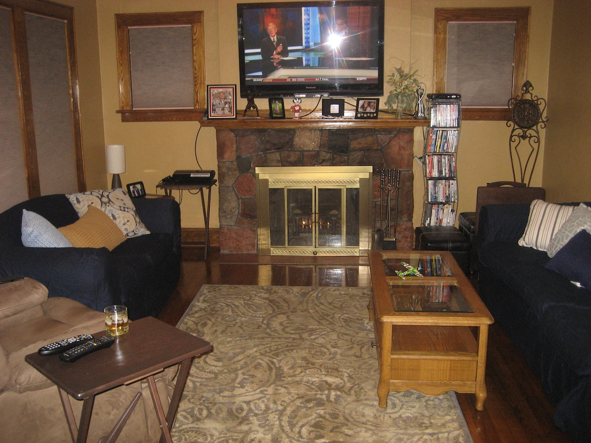 """Spacious living room with HBO, 50"""" TV, Wii, PS3, and DVD/Blu-ray collection."""