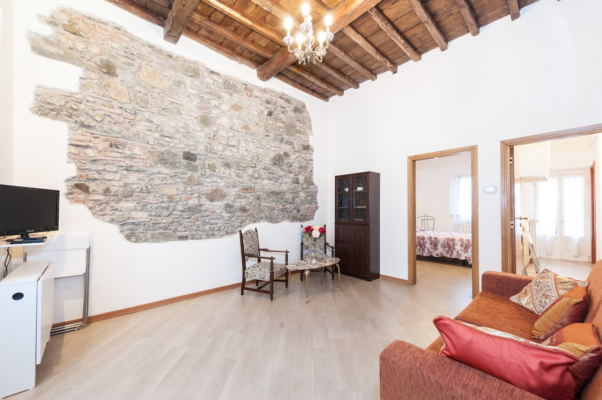 Living room with original stone wall late 1800s.
