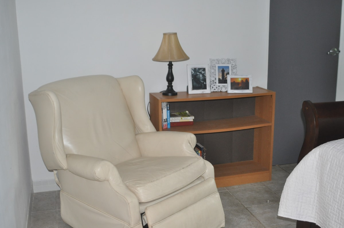 Master bedroom reading area with a few books to enjoy at the beautiful beach