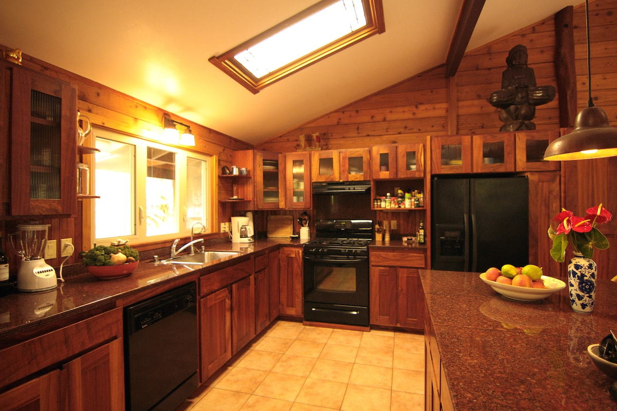 koa and granite kitchen with everything you need to cook except the food