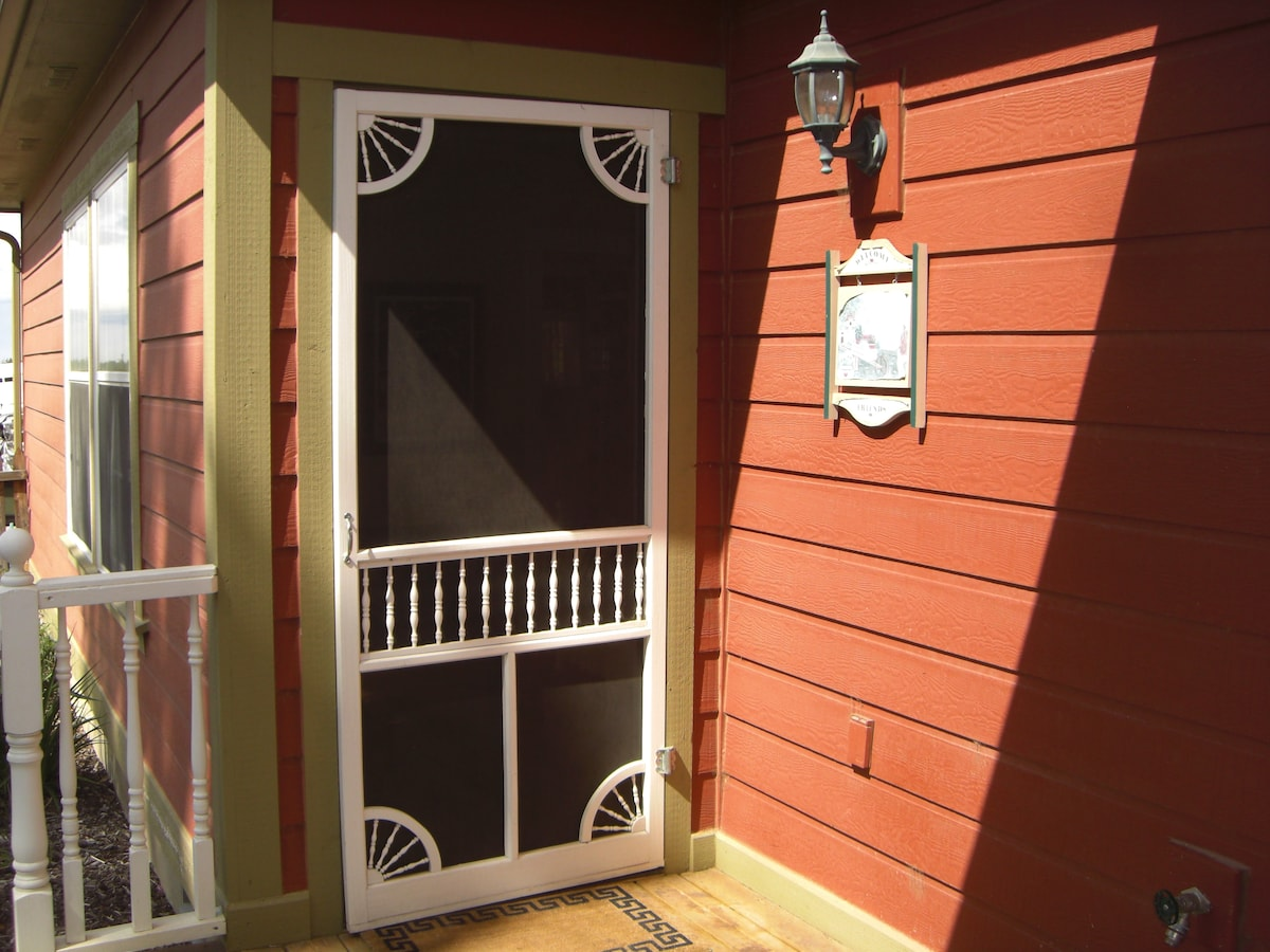 Guest room entrance.  Left of front door off porch.  Bistro table and chairs for looking at the mountain views.