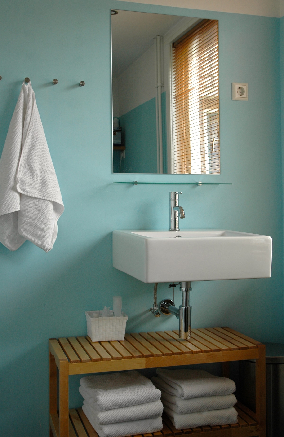 Sparkling clean private bathroom with fresh towels,