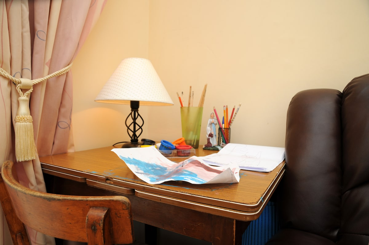 area to read, study, draw or paint in a bright spacious Guest Room