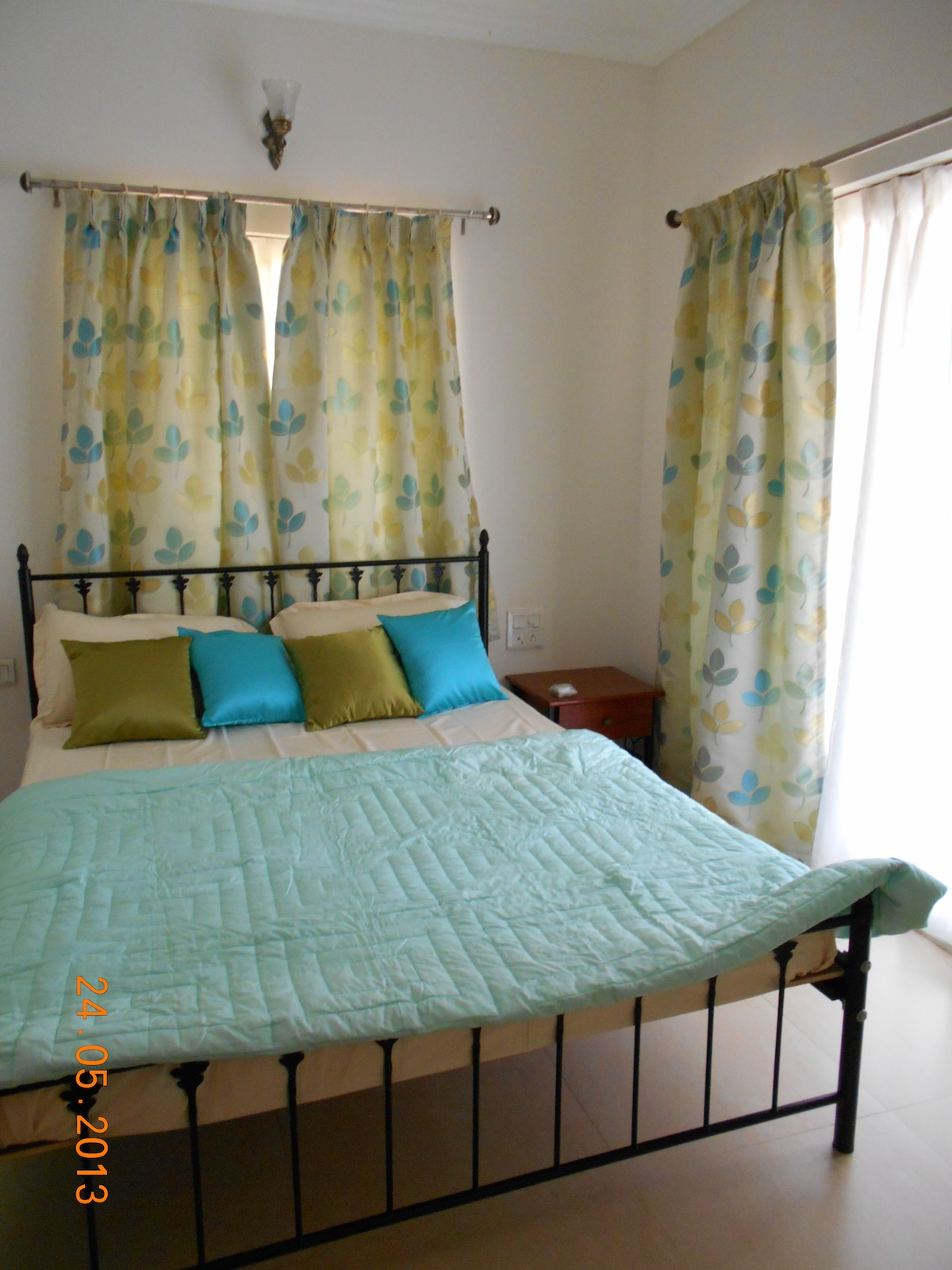 The bedroom is inviting, done up in cool pastels it overlooks the main entrance gate and the security guard is always at your beckon call