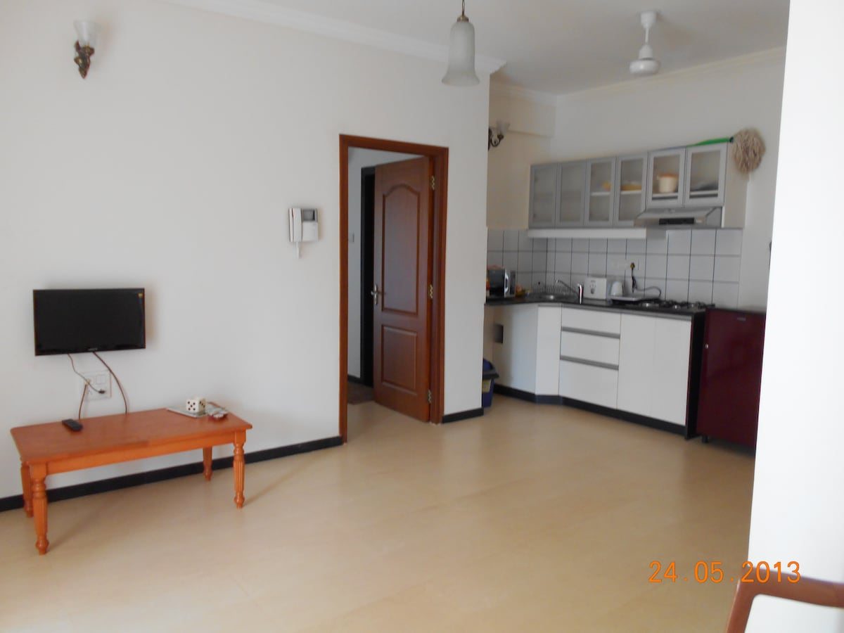 A small kitchenette with modern amenities such as Fridge, Microwave, Electric kettle, Induction cooker/Hot plate