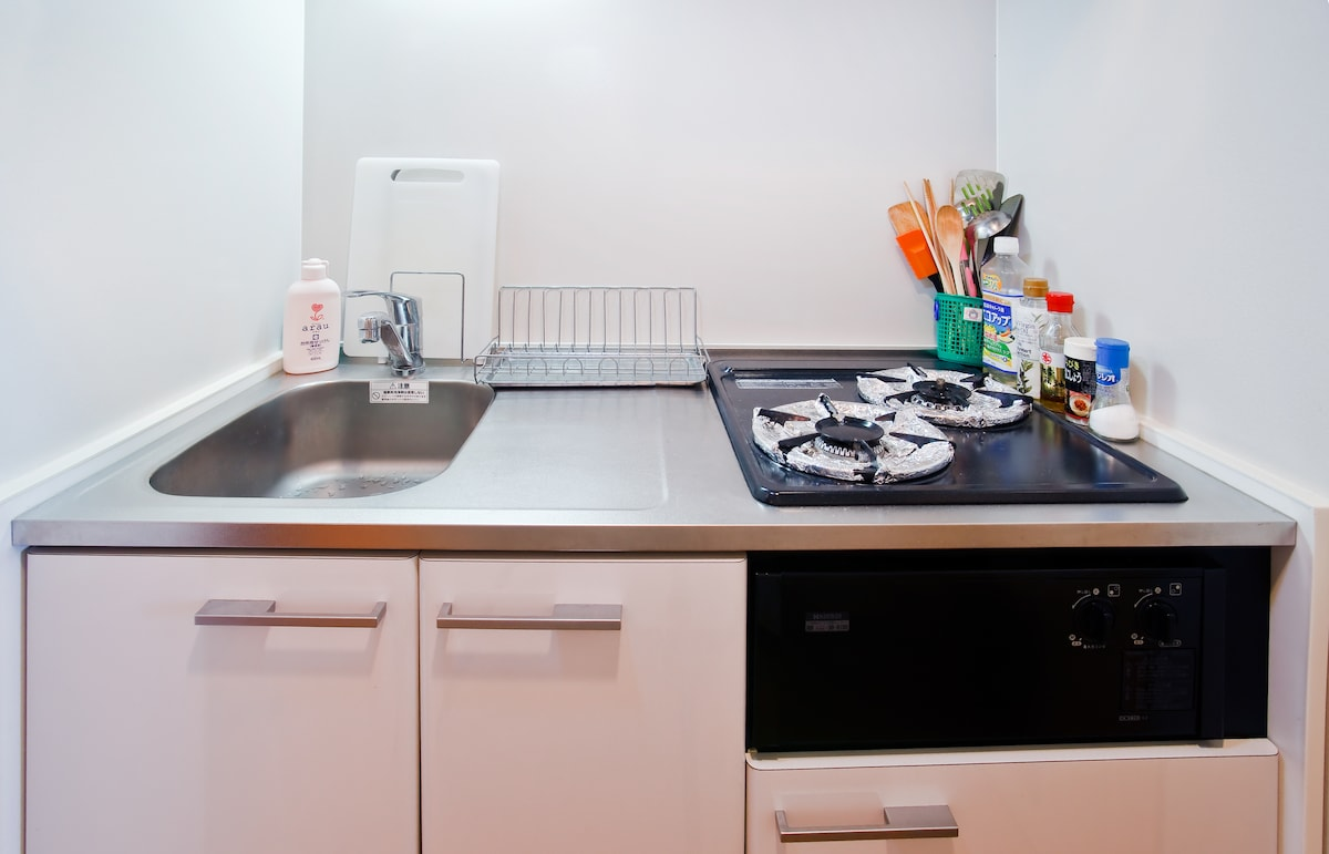 Our clean kitchen is supplied with pots, pans and all cooking utensils.