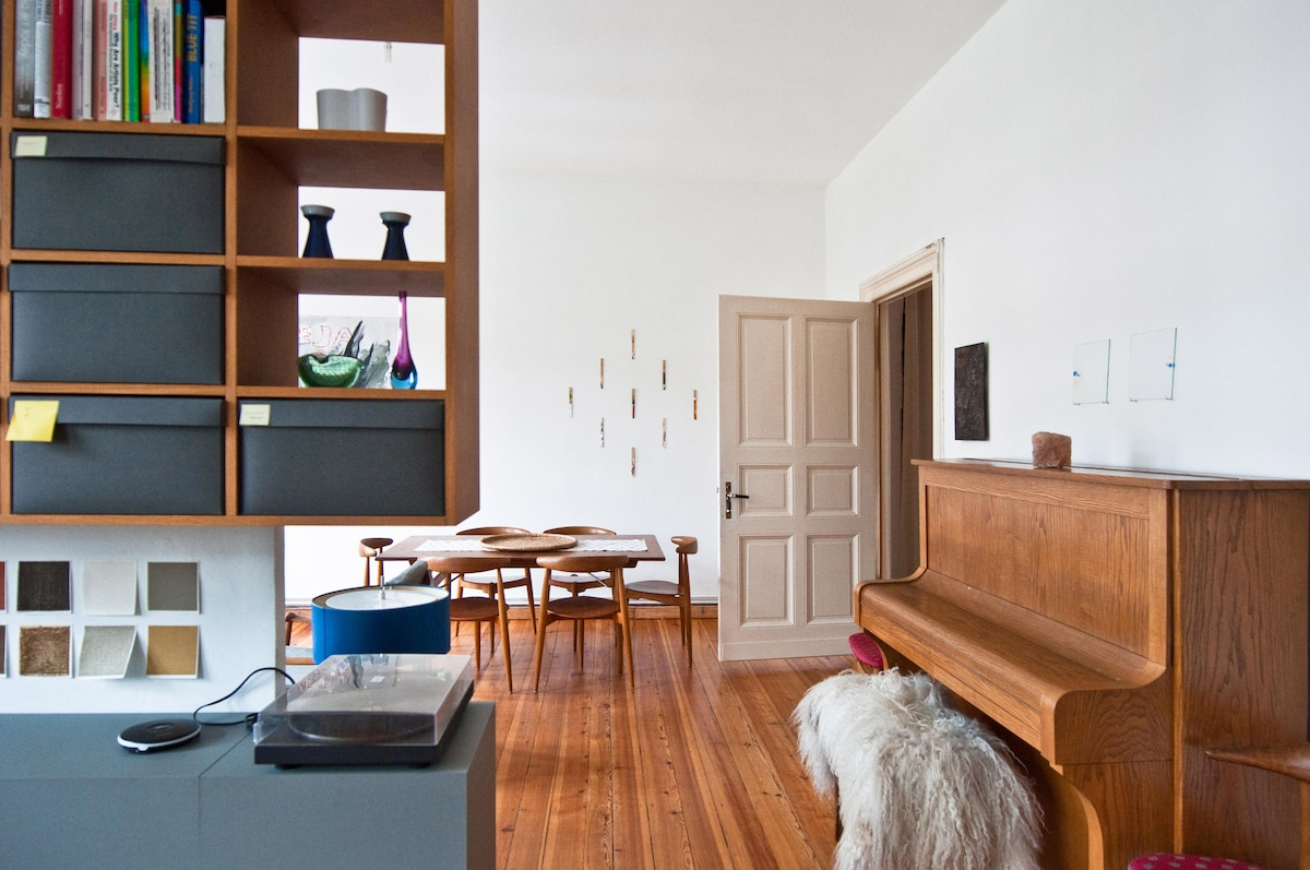 View from office space into the living room, the door enters into the bedroom