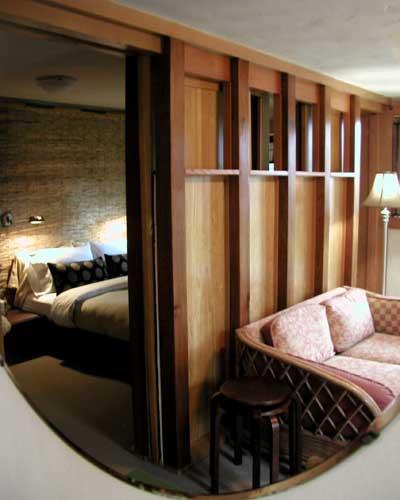 bedroom tucked behind living room