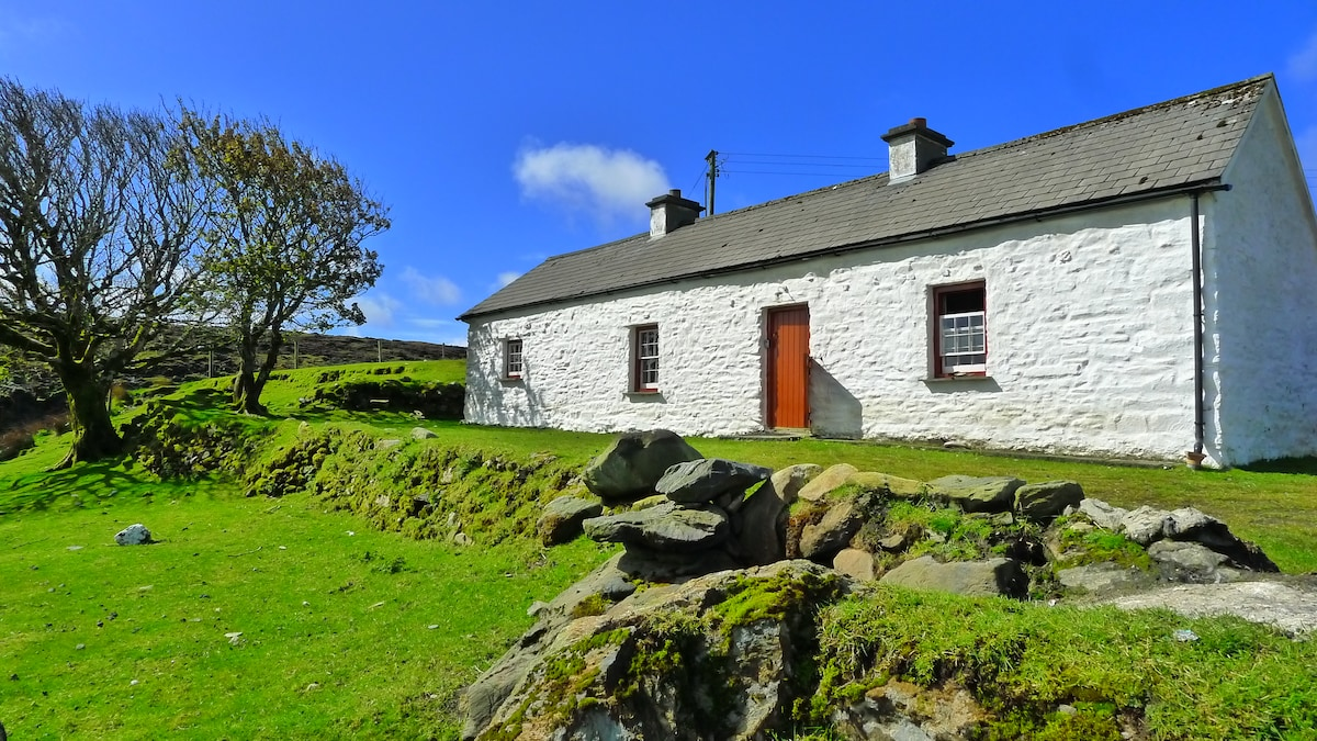 traditional, authentically restored Donegal cottage with remarkable interior and views. Walk to beach. Photo May 2013