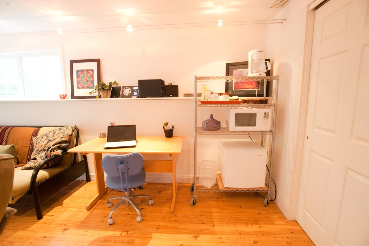 Plus a working desk  (free wireless access) and your own mini kitchen station with coffee/tea makers, toaster, fridge and  microwave.