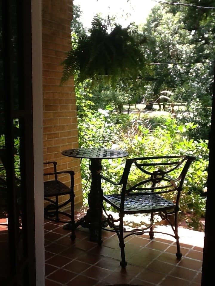 Relax at the cast iron table and chairs on your private front porch overlooking Audubon Park.