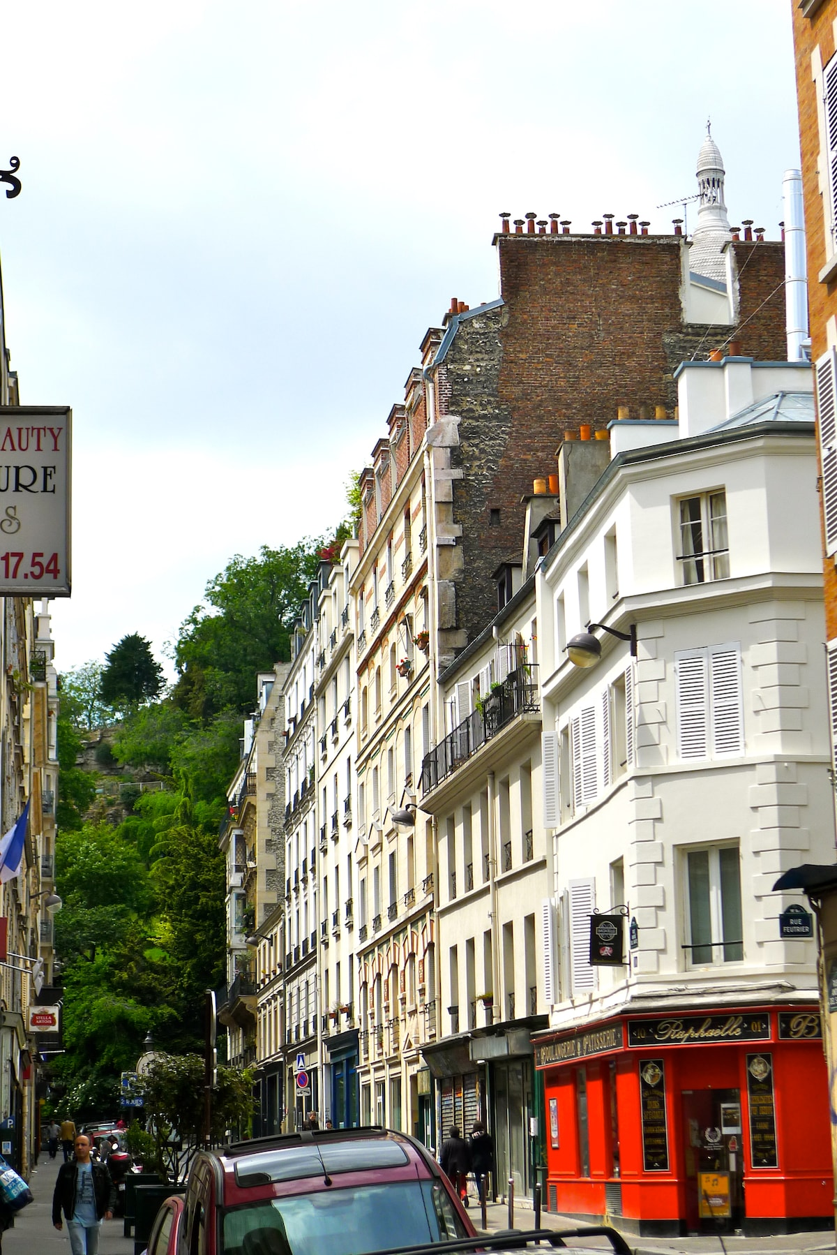 The hill of Montmartre (the building is the one with the red bakery literally at the foot of the Sacré Coeur)