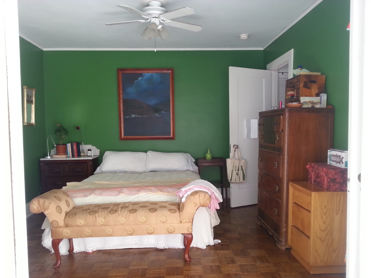wider view of master bedroom