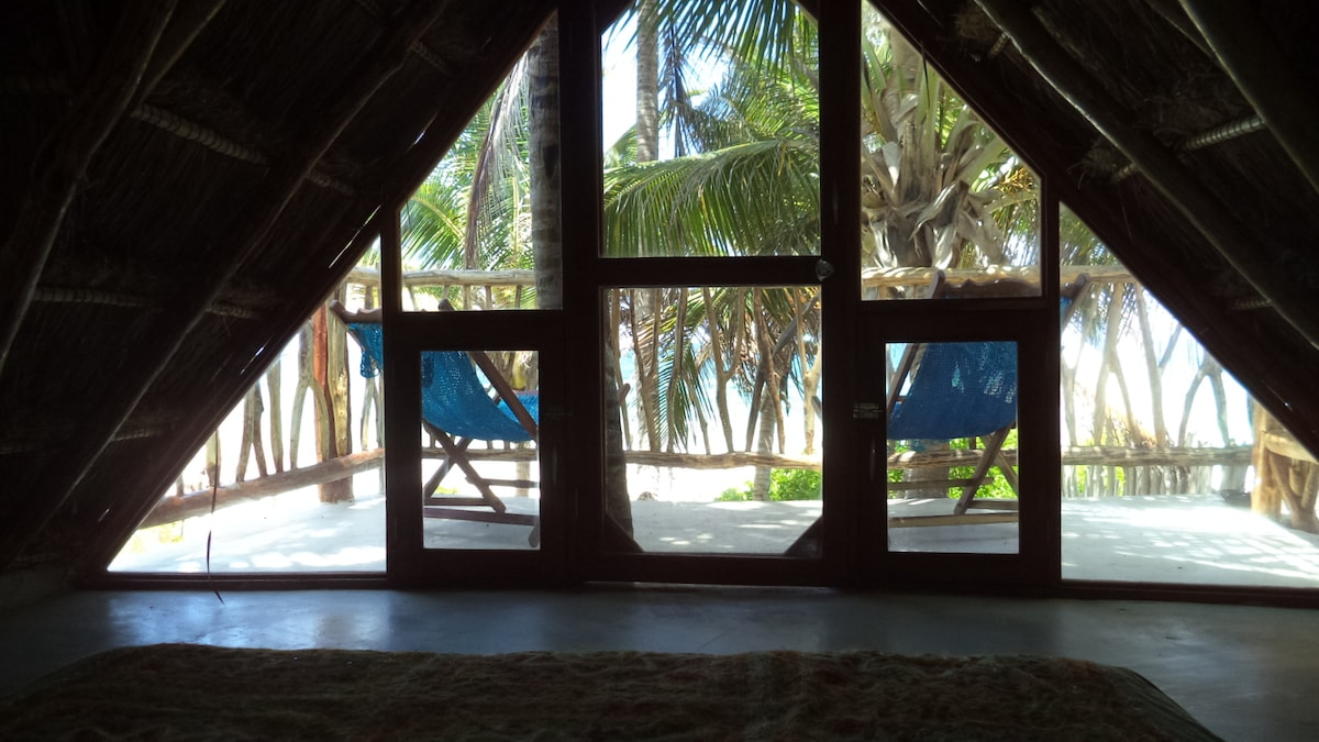Whatch the sea from your bed. When the entrance door and the window are open, nice breeze comes through them.