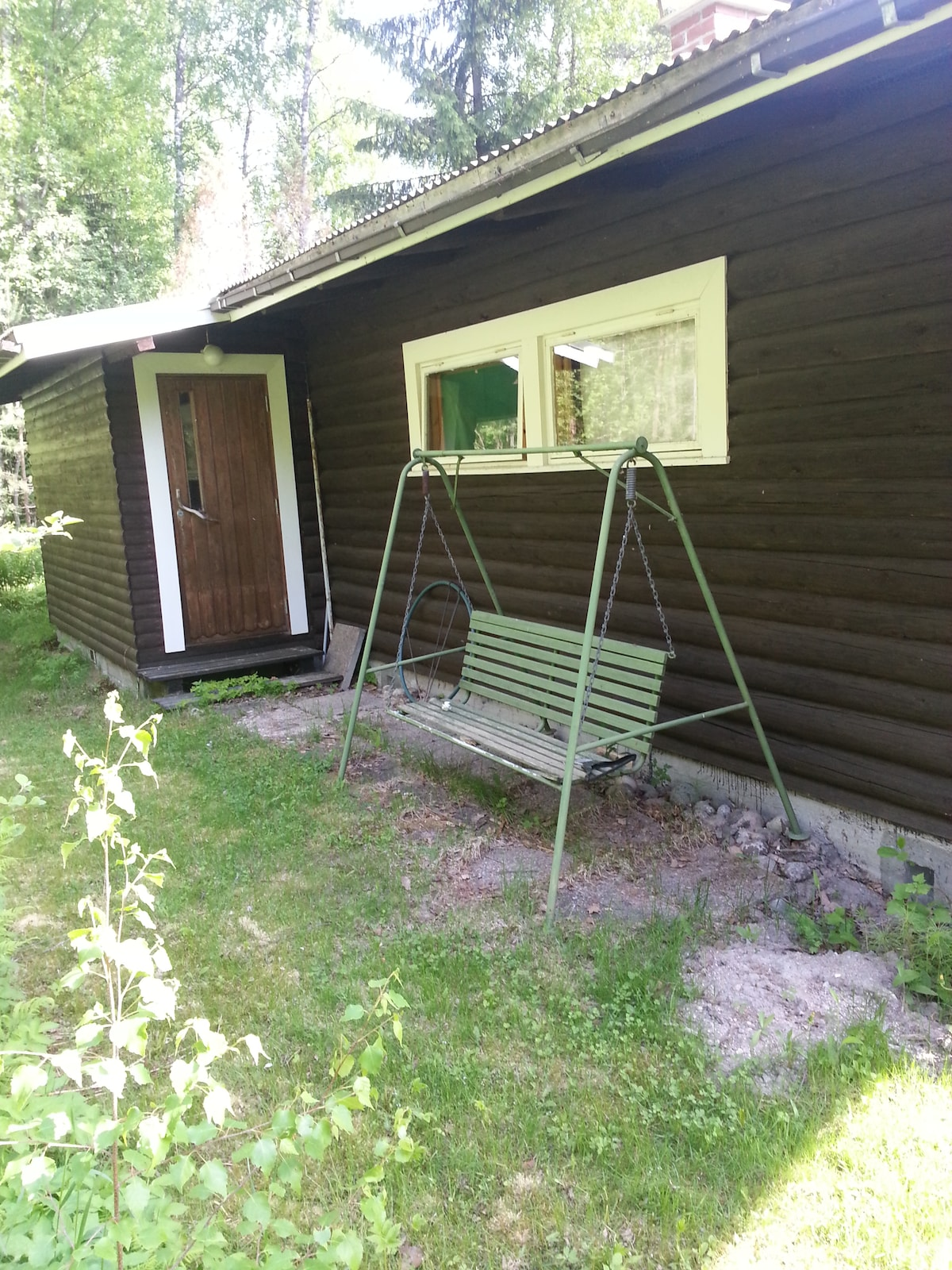 One of the swings and the cabin from one side.