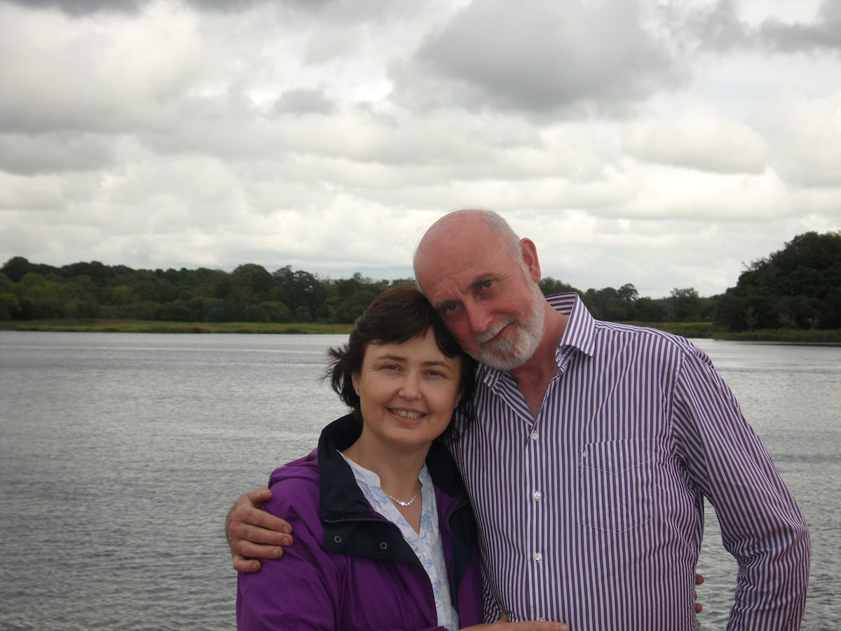 The happy proprietors, Tommy &  Patricia Timlin surrounded by the natural beauty of the area.
