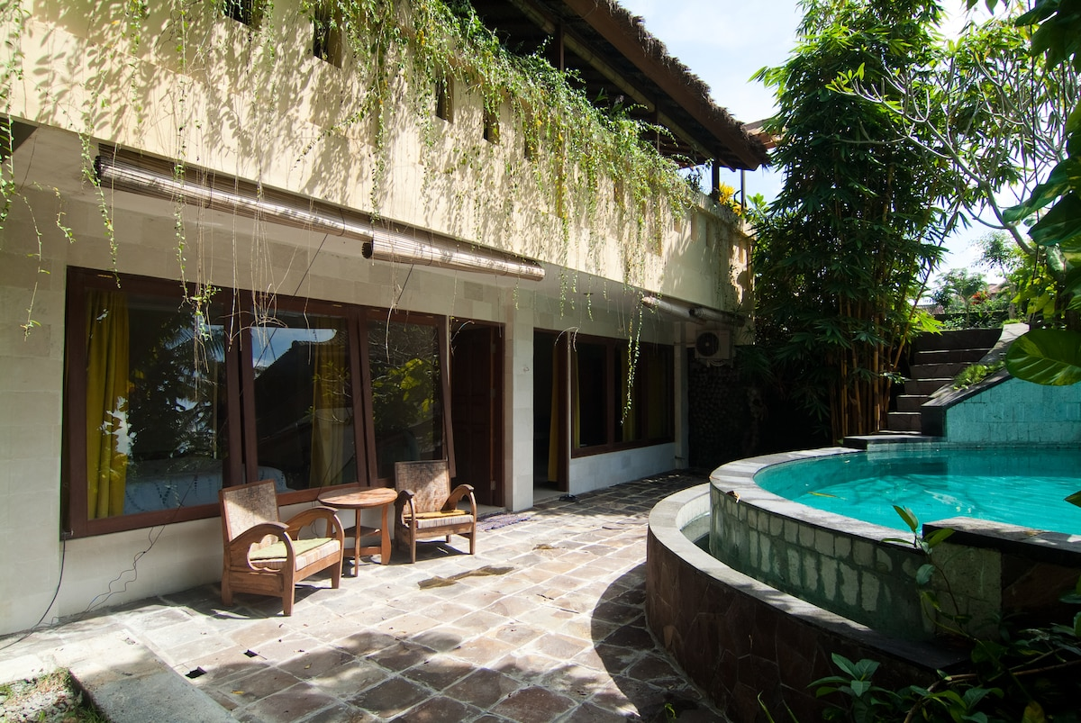 Terrace of the room is at the edge of the swimming pool.