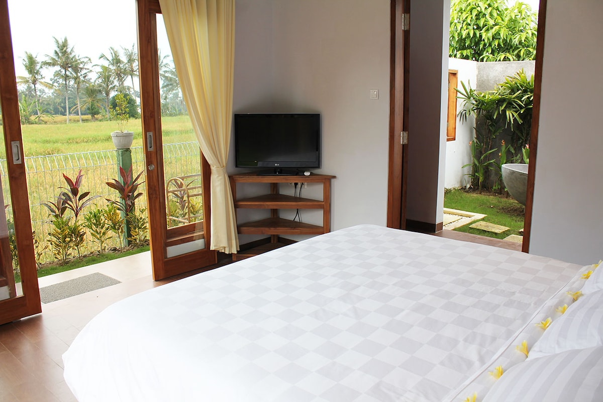 Magnificent views of the rice fields and outdoor bathroom from the separate guesthouse.
