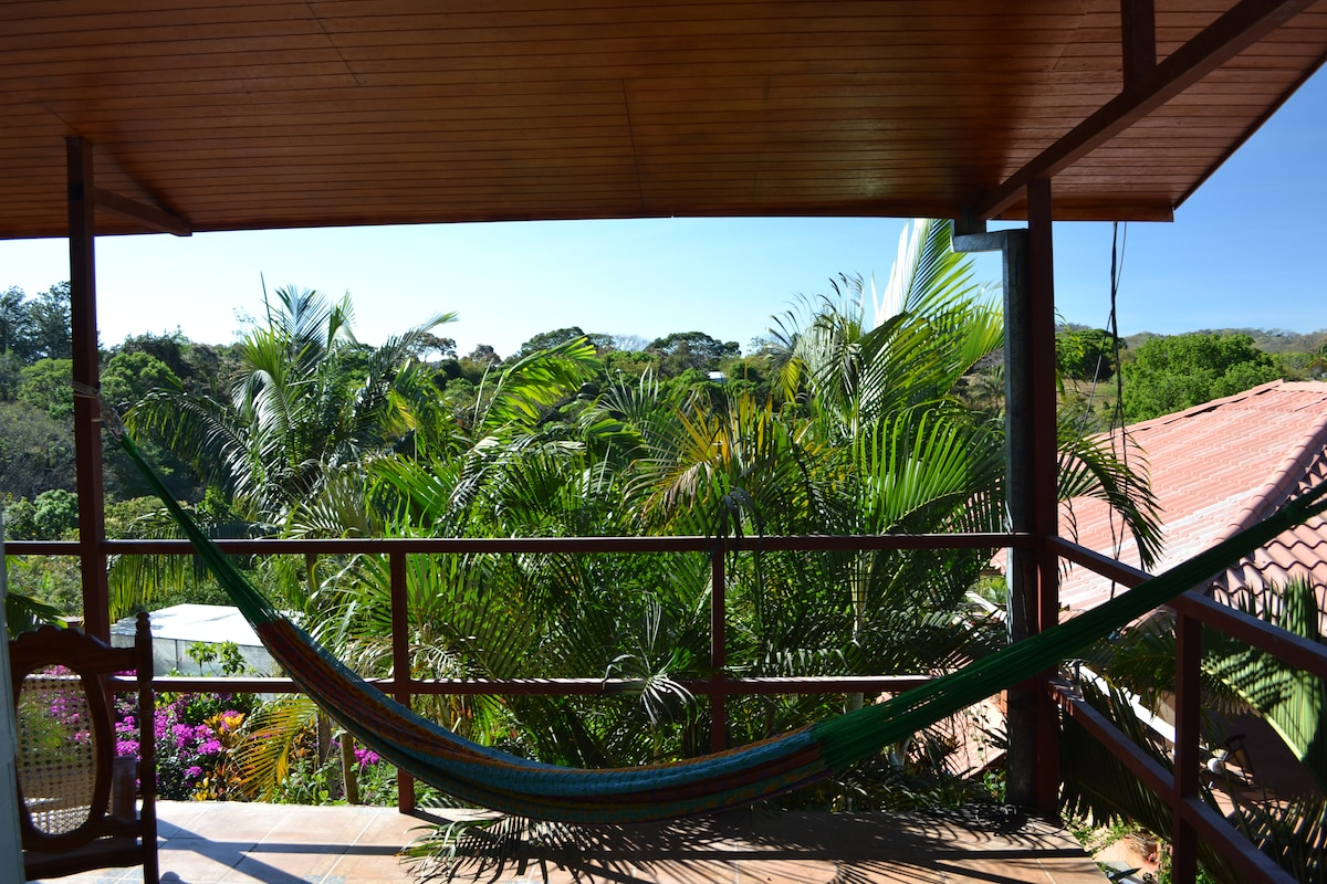 3 person hammock on veranda of guest house