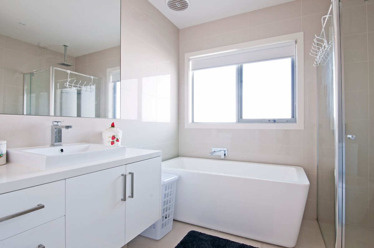 Your guest bathroom upstairs boasts a large, free standing bath, rain shower head and toilet.
